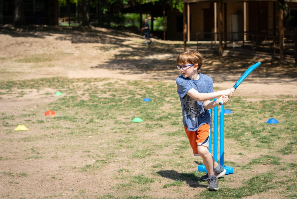 boy batting ball