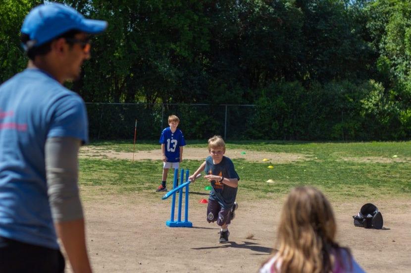 boy running to cricket wicket
