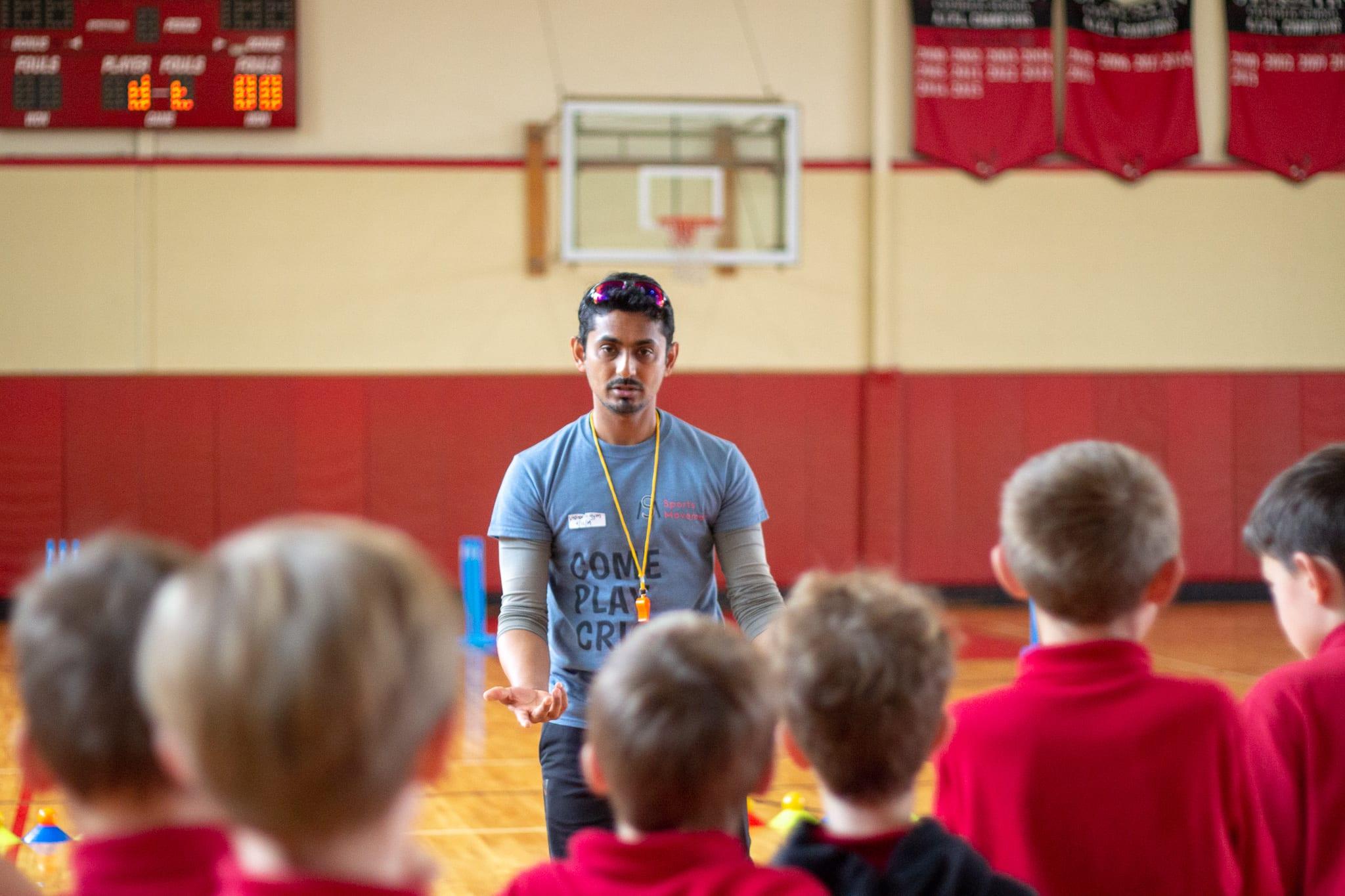 coach raghav talking to student athletes
