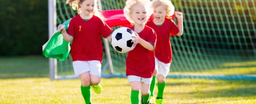 Portugal football fan kids. Children play soccer.